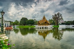 Lake in Bang Pa-In Royal Palace near Ayutthaya, Thailand (UweBKK (α 77 on )) Tags: ayutthaya province thailand southeast asia sony alpha 77 slt dslr chao phraya river water flow stream lake reflection sky cloud grey bangpain bang pain royal palace tree bush garden lamp post park museum