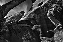 Approaching and Taking in the Full Breath of the Double O Arch (Black & White, Arches National Park) (thor_mark ) Tags: archesnationalpark azimuth187 blackwhite blueskies blueskieswithclouds canyonlands capturenx2edited centralcanyonlands cloudwisps clouds colorefexpro coloradoplateau day7 desert desertlandscape desertmountainlandscape desertplantlife desertvegetation devilsgardenloop devilsgardenlooptrail devilsgardentrail devil'sgardentrail doubleoarch highdesert intermountainwest junipertrees landscape largebushes layersofrock lookingsouth naturalarch naturalarches nature nikond800e outside partlysunny portfolio project365 rockformations sandstonearch sandstonecanyonwalls sandstonefin sandstonewalls sunny trees utahhighdesert utahnationalparks2017 ut unitedstates