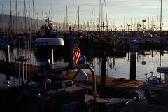 2020-01-25, 06h00m38s, boat, film, flag, harbor, Kodak Ektachrome 100, morning, Santa Barbara, scan (markalanthomas) Tags: kodakektachrome100 santabarbara boat film flag harbor morning scan