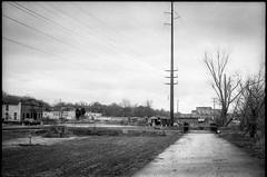 urban decay, power lines, roadway, near dusk, River District, Asheville, NC, Pentax Spotomatic, Super Takumar 50mm f-1.4, FPP Derev Pan 400, HC-110 developer, 1.17.20 (steve aimone) Tags: urbandecay powerlines roadway neardusk riverdistrict asheville northcarolina pentaxspotomatic supertakumar50mmf14 fppderevpan400 hc110developer 35mm 35mmfilm film analog blackandwhite monochrome monochromatic
