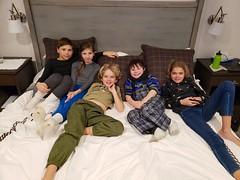 Kids On Our Bed Watching Middle School (Joe Shlabotnik) Tags: 2020 galaxys9 january2020 vermont violet everett gideon abigailj okemo cameraphone elias