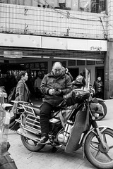Phone rider (Go-tea 郭天) Tags: chongqing républiquepopulairedechine man motorbike motorcycle rider ride stoped break cell cellular cellphone mobile phone check checking data network connected connexion alone lonely portrait cold winter street urban city outside outdoor people candid bw bnw black white blackwhite blackandwhite monochrome naturallight natural light asia asian china chinese canon eos 100d 24mm prime