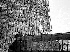 glass palace (heinzkren) Tags: blackandwhite monochrome schwarzweis vienna wien street bridge windows woman reflection architecture lumix person streetphotography panasonic human architektur abstract spiegelung structures texture pattern tower skyscrapper silhouette