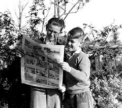 Two boys reading newspaper comics (Michael Vance1) Tags: art adventure artist anthology aliens comics comicbooks cartoonist comicstrip fantasy humor horror sf sciencefiction satire suspense superhero supernatural monsters mutant newspaper
