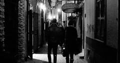 Night prowling. (Baz 120) Tags: candid candidstreet candidportrait city contrast street streetphoto streetcandid streetportrait strangers sony a7 rome roma europe women monochrome monotone mono noiretblanc bw blackandwhite urban life portrait people provoke italy italia grittystreetphotography decisivemoment night