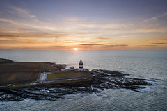 Hook Lighthouse at dawn (Sean Hartwell Photography) Tags: hook lighthouse irishlights wexford ireland sunrise dawn sun ocean atlantic sea seaside rocks