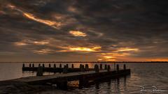 Sunset on a cloudy day (BraCom (Bram)) Tags: 169 bracom bramvanbroekhoven goereeoverflakkee grevelingen grevelingenmeer holland nederland netherlands slikkenvanflakkee southholland veermansplaat zuidholland avond cloud evening jetty lake meer palen poles reflection rustig silhouetten silhouettes sky spiegeling steiger sunset tranquil water widescreen wolk zonsondergang