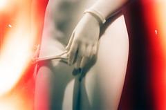 Peep Show (Gabriella Ollandini) Tags: body nude woman lady statue neon lightleak red 35mm analog analogica analogue lomography 800 experimental sensual erotic filmisnotdead filmphotography filmcamera film istillshootfilm illuminated handcuffs hand alabaster torso naked flash bondage feminine female captive prisoner