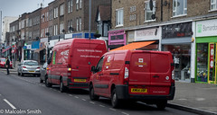 Post & Parcels (M C Smith) Tags: southchingford shops pentax k3 post van vans parcelforce pavement road parking white black blue green orange walking crossing line lines awning hangingbaskets flowers purple lamps buildings flats offices silver shopping delivering aerials sky clouds signs