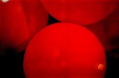 Red Balloons (Gabriella Ollandini) Tags: balloons red neon illuminated abstract moon dreamy 35mm analog analogica analogue istillshootfilm kodak ricoh kr5 200 whimsy contrast circles shapes filmisnotdead filmphotography filmcamera film filmnegative night saturated close party disco dots