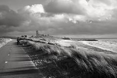 heavy skies and great light (peer.heesterbeek) Tags: light skies sea water sand coast runner sun vlissingen zeeland netherlands blackwhite monochrome