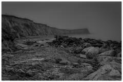 Reculver in the Mist. (newtym8) Tags: weather fog mist waves seengland leadingline rocks kitlens cliffs beach sea blackandwhite mono reculver landscape seascape coast kent nikond3500