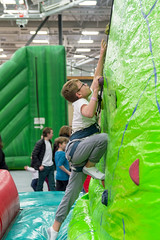 Climbing Up and Infatable Wall (aaronrhawkins) Tags: boy climb wall climbing rock inflatable play provo recreation center stretch harness child childhood joshua aaronhawkins