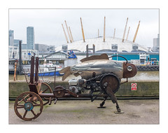 Walking Chariot  & O2 Arena (Formerly the Millennium Dome), Trinity Buoy Wharf, Poplar, East London, England. (Joseph O'Malley64) Tags: chariot steampunk vehicle invention walkingchariot aquagill mechanism mechanical engine engineering mechanics chaindriven cam fish fueltank transport folly o2dome o2arena dome milleniumdome openedon31stdecember1999 millenium trinitybuoywharf wharf poplar eastlondon eastend london england uk britain british greatbritain pier ferry ferryboat promentary thames riverthames concrete docklands londondocklands towers offices officeblocks urban urbanlandscape fujix fujix100t accuracyprecision documentaryphotography britishdocumentaryphotography