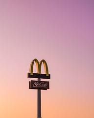 Wanna Coffee? (Konrad Niechwiej) Tags: evening sunset sky city mcdonalds sign landmark m cloudless