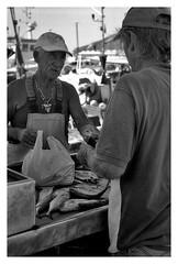 contrattazione al mercato ittico locale di Favignana, isole Egadi. (MarcoBertarelli) Tags: marketplace egadi sicily favignana monochrome monochromatic bw people street photography fisherman bargaining fish