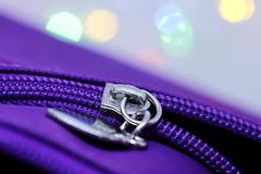 Zip Zap purple in the space (Christian Chene Tahiti) Tags: canon 6d macro macrolens polynésie hmm bokeh jaune vert bleu pourpre purple rose tahiti paea macromondays zipper fermeture anneau pochette voyage fermetureéclair