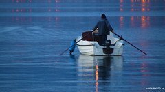 Fishing into night (malioli) Tags: fishing boat twilight night canon sea water reflection