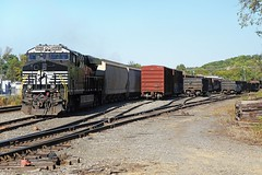 Norfolk Southern Railroad GE ES44AC locomotive # 8063 with its short local train is seen prior to the cab crew boarding at a small yard in Johnson City, Tennessee 10-3-2017 (alcomike43) Tags: norfolksouthernrailroad johnsoncitytennessee yard freightcars boxcars gondolas coveredhoppercars city industrialarea railroads trains freighttrain localfreighttrains manifestfreighttrains tracks rails ties roadbed ballast siding rightofway mainline weldedribbonrail jointedsectionrail switch turnout manualswitchmachine anglebar tieplate spike locomotive engine diesel ge es44ac 8063 dieselengine diesellocomotive dieselelectriclocomotive photo photograph color digitalimage