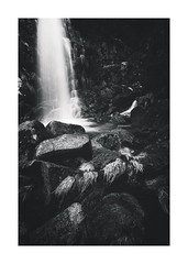 Resilience (RuiFAFerreira) Tags: bw black blackwhite white canon efs1018mmf4556isstm exterior light landscape longexposure le mood monochromat monochrome nature portugal park rocks shadow textures wide waterscape water waterfall