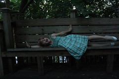 Cheese! (logan zarobinski) Tags: bench trees outside dress girl picture portrait