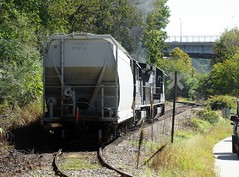 Norfolk Southern Railroad GE B23-8 locomotives # 3538 & # 3522 lead a covered hopper car on the Riverside Drive branch line up the incline grade to the main line and yard in Asheville, North Carolina 9-28-2010 (alcomike43) Tags: norfolksouthernrailroad ashevillenorthcarolina city riversidedrive branchline vehicles highwaybridge tracks rails ties roadbed ballast rightofway jointedsectionrail coveredhoppercar freightcars gradecrossing crossbuck locomotives engines diesels ge b238 dieselengine diesellocomotive dieselelectriclocomotive photo photograph color digitalimage