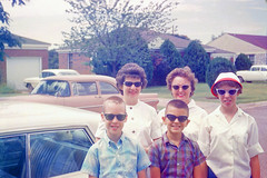 1950's family with sunglasses (GreenOwl70) Tags: 1950s family sunglasses vintage neighborhood street cars retro plaid shirt houses 50s
