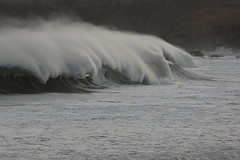 Light in the wave (mootzie) Tags: waves froth spray white blue sea light ness lewis scotland nature