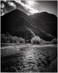Kamikōchi - One More (niggyl :)) Tags: kamikōchi chubusangakunationalpark naganoprefecture azusariver ricoh ricohgrii ricohgr2 grii ricohimaging ricohgr wideangle ultrawideangle wideangleprimes primelens breathtakinglandscapes landscape cloud cloudscape clouds sky cloudsstormssunsetssunrises tree trees forest dxolabs nikcollection blackandwhite bw monochrome monochromatic bnw bnwlandscape lowkeyblackandwhite silverefexpro silverefexpro2 nationaltreasure parks nationalpark japanesealps mountains valleys alpine alps rivers ripples water