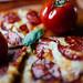 Pepperoni pizza with raw tomattoe