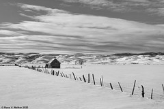 Little Barn, Big Valley - Black and White Version 3 (walkerross42) Tags: barn farm ranch fence valley mountains bearriverrange wasatch bearlakevalley montpelier bennington idaho snow winter cold clouds sky blackandwhite monochrome