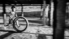 Not one for spinning wheels (Frank Busch) Tags: frankbuschphotography photobyfrankbusch asia blackwhite blackandwhite blurr bnw boy child children laos monochrome running tire travel travelling travelphotography village villagelife wheel wwwfrankbuschname