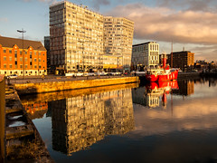 Canning Dusk (stephenbryan825) Tags: albertdock britain canningdock england europe greatbritain liverpool merseyside northwest planetliverpool uk unitedkingdom architecture boats buildings construction dramaticlight dusk dwelling edifice glass lightboat manmade property red reflection structure vessels water