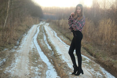 Hot and Cold (Pavlo Kuzyk) Tags: girl blonde shirt jeans heels road trees snow winter nature canon