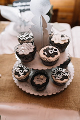 A few small cupcakes on display with different words on them (i do, bride team) (shixart1985) Tags: cookies indoors chocolate cupcake cupcakes display sugar sweet table tasteful tasty