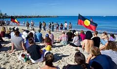 Passionate Words (Padmacara) Tags: australia fremantle oneday ocean sand beach people aboriginalflag