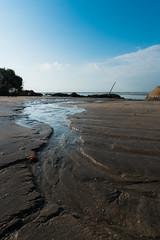 Flow to ocean (Ajai Arif) Tags: beach water sand sea sunset landscape sky nature seascape surf vertical colorimage wide nopeople watersedge sunrisedawn sun sunny outdoors coastline wideshot wideangle nonurbanscene day scenicsnature sony a6300 selp1650