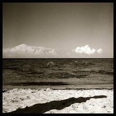 one shadow (Claudio Taras) Tags: bw bokeh biancoenero shadow sky mare nuvole monocromo monochrom medioformato filmisnotdead film hasselblad501cm hasselblad sardegna square claudio contrasto taras rodinal