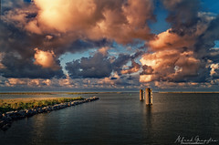 With The Sun In Your Back You Have At Least Some Light On Your Track (Alfred Grupstra) Tags: sea cloudsky nature sunset sky water harbor cloudscape pier landscape coastline dusk outdoors blue beach summer scenics reflection weather horizonoverwater 969 lake ijsselmeer