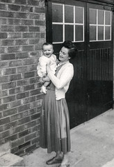 mother nad baby by the garage door (Colin John Ford) Tags: found old vintage mother baby door