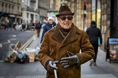 Hat, Coat, Gloves (Leanne Boulton) Tags: urban street candid portrait portraiture streetphotography candidstreetphotography candidportrait streetportrait eyecontact candideyecontact streetlife old elderly man male face eyes expression mood emotion feeling hat gloves coat sheepskin brown tan tone texture detail depthoffield bokeh style fashion cold winter naturallight outdoor light shade city scene human life living humanity society culture lifestyle people canon canon5dmkiii 50mm primelens ef50mmf14usm colour glasgow scotland uk