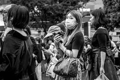 Tokyo 2019 (burnt dirt) Tags: shibuya tokyo japan asia japanese asian candid documentary street photography downtown metro urban city scramble crossing outdoor people person fujifilm xt3 fujinon 50mm f2 bw blackandwhite monotone monochrome woman girl smile laugh train station style fashion life real crowd tourist emotion expression portrait close nippon mask eye contact