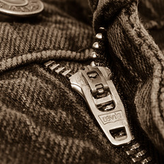 Levi's zip puller (mikeplonk) Tags: macromondays zip zipper levis jeans black nikon d5100 micro macro 40mm square closeup denim sepia button nikkor