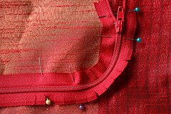 How to sew a Zipper around a corner (Chandana Witharanage) Tags: srilanka southasia macromondays macrophotography macro zipper material pins creativephotography colourful red attraction background beautiful closeup handheld interesting lovely naturallight photographer photography tabletop canoneos7d ef100mmf28lmacroisusm photographybychandanawitharanage
