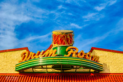 Drum Room (Kool Cats Photography over 13 Million Views) Tags: sign horizon horizontal architecture artistic art abstractart colorful photography clouds landscape colors red yellow green blue bluesky drum text