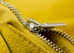 In the Bag (Helen Orozco) Tags: macromondays zipper hmm zip bag teeth fastener yellow macro focus textures