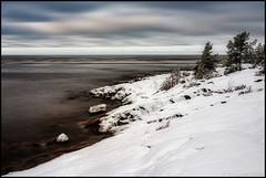 (Jonas Thomén) Tags: cliffs klippor snow snö sea hav havet water vatten clouds moln himmel sky träd trees stenar rocks winter vinter fäboda longexposure långexponering