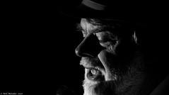 Deep Blue in Black (Neil. Moralee) Tags: anything but blues singer man male old mature wrinkled beard contrast harsh close portrait face black white mono monochrome blackandwhite blackwhite neil moralee bw blackbackground candid nikon hemyock devon uk british music tune soul musician performer artist hat 7100