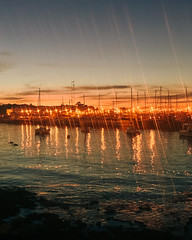 Golden and silver stars (ninasclicks) Tags: harbour ships stars sea sunset puntadeleste uruguay iphone11pro