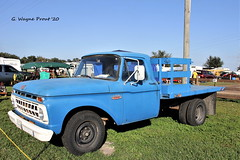 1965 Ford F-350 Flatbed Truck (Gerald (Wayne) Prout) Tags: 1965fordf350flatbedtruck fordf350flatbedtruck 1965 ford f350 flatbed truck 33rdannualantiqueengineandtractorswapmeet floridaflywheelersantiqueengineclub fortmeade polkcounty florida usa prout geraldwayneprout canon canoneos60d eos 60d digital dslr camera canonlensef70300mmf456isusm lens ef70300mmf456isusm photographed photography vehicle machine farming antique historical old fort mead polk county stateofflorida
